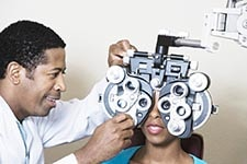 Optometrist treating patient