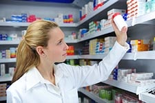 Pharmacist pulling prescription
